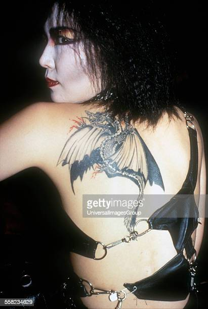 An Asian goth girl with dragon tattoo on her back 1980