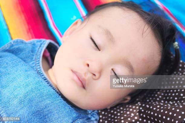 An asian little girl sleeping