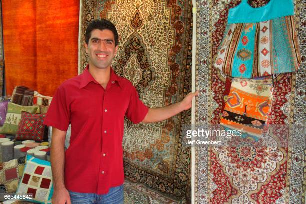 An Asian man selling oriental rugs at Kampong Glam