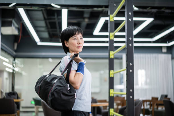 An Asian middle-aged woman goes to the gym