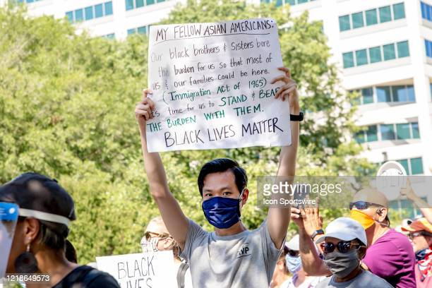 An Asian protester marches with a sign expressing appreciation for AfricanAmericans during the City Collective Prayer March on June 7 in Norfolk VA...
