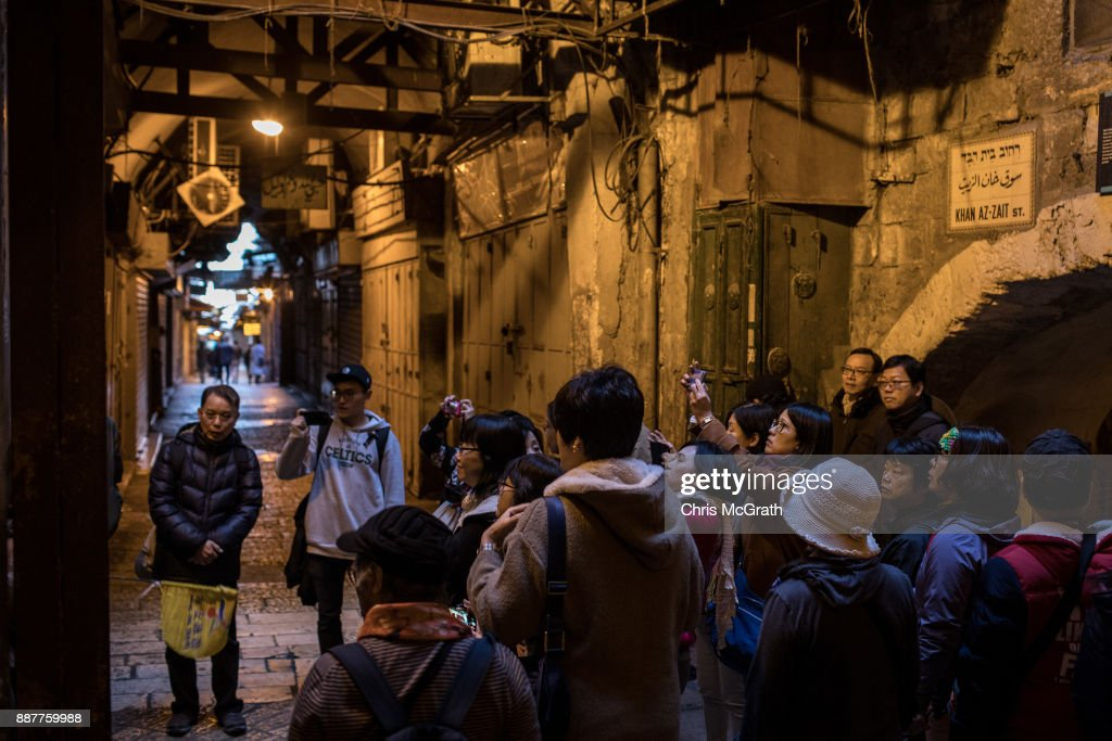 An asian tour group walks through the Old City on December 7, 2017 in Jerusalem, Israel. Tension is high in Jerusalem a day after U.S President Donald Trump's announcement recognizing Jerusalem as the capital of Israel. President Trump went ahead with the announcement despite warnings from Middle East leaders and the Pope condemning the decision. Clashes between Israeli forces and Palestinian protesters erupted in several West Bank cities.