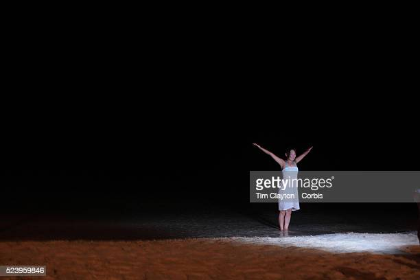 An asian tourist is photographed on White Beach at night in Boracay Island the Philippines The 4 km stretch of White beach on Boracay Island has been...