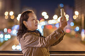 an asian woman is taking photo