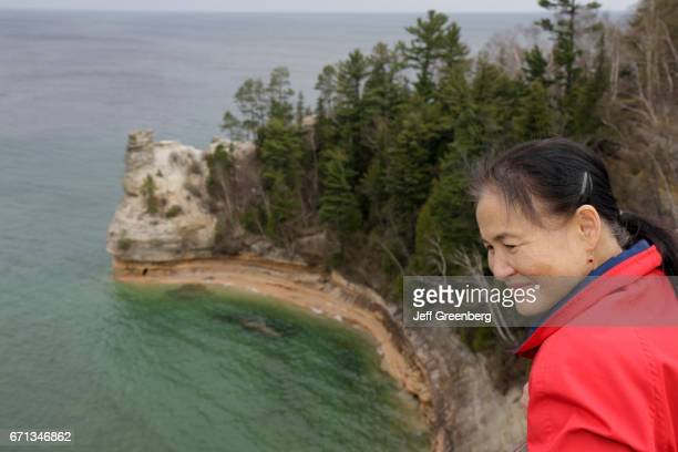 An Asian woman looking at the Great Lakes.