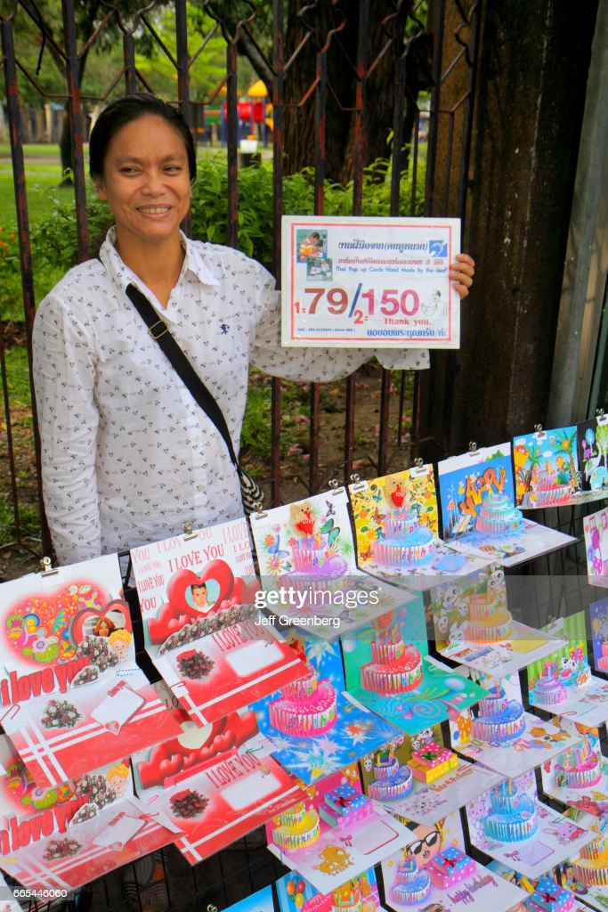 An asian woman selling greeting cards at the jatujak weekend market an asian woman selling greeting cards at the jatujak weekend market m4hsunfo