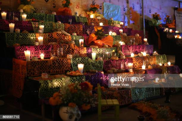 An aspect of a traditional Mexican offering placed outside a building damaged by the September 19th earthquake In this collapsed building 9 people...