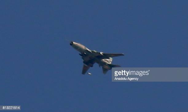 An Assad regime forces' war plane is seen over the deconflict zones Jobar district and Ayn Terma town in the Eastern Ghouta region of Damascus Syria...