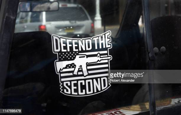 An assault rifle decal on a gun rights advocate's pickup truck urges the defense of the US Constitution's Second Amendment