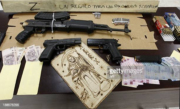 An assault rifle semiautomatic pistols ammo and other stuff seized in the arrest of ten alleged members of the drug cartel Los Zetas are presented to...