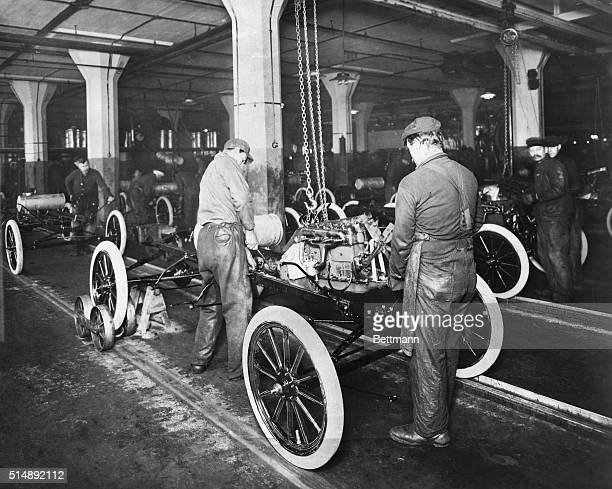 An assembly line in Ford factory Dropping the Ford engine into the Model T ChassisHighland Park C Michigan