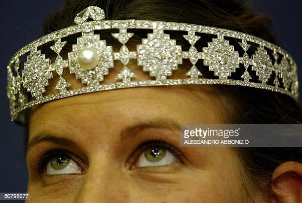 An assistant at Christie's auction house wears a diamond incrusted platinum bandeau made by Cartier valued at 150200000 USD formerly owned by heiress...