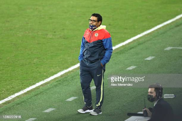 An assistant coach takes over the second half duties after head coach Miguel Herrera of Club America was not allowed on the sidelines during the...