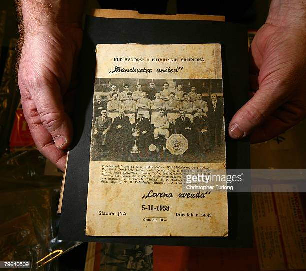 An assistant from Goldeman James Auctions shows off an original football programme from the Red Star Belgrade game against Manchester United the last...
