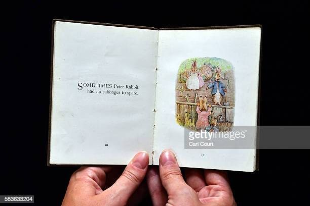 An assistant holds a first edition of The Flopsy Bunnies by Beatrix Potter at Dreweatts and Bloomsbury Auctions on July 27, 2016 in London, England....