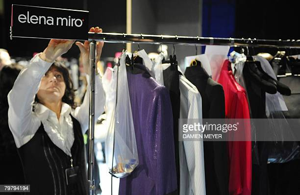 An assistant is pictured backstage before Italian fashion designer Elena Miro show during the Autumn/Winter 2008/2009 women's collections at Milan...