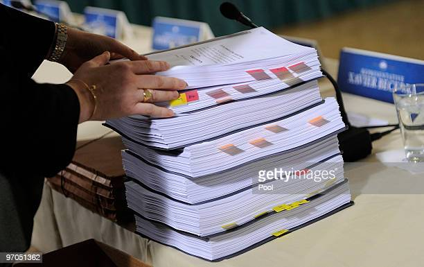 An assistant places healthcare documents onto the meeting table before a bipartisan meeting to discuss health reform legislation with congressional...