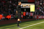 southampton england an assistant referee flags