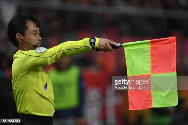 An assistant referee indicates an offside during the JLeague J1 Promotion PlayOff Final between Nagoya Grampus and Avispa Fukuoka at Toyota Stadium...