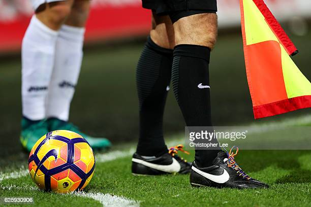 An assistant referee is seen during the Premier League match between Swansea City and Crystal Palace at Liberty Stadium on November 26 2016 in...