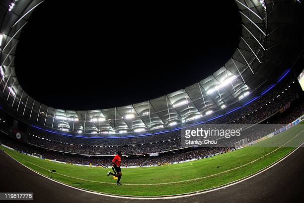 An assistant referee runs along the line during the pre-season friendly match between Malaysia and Chelsea at Bukit Jalil National Stadium on July...