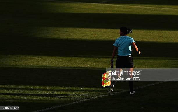 An assistant referee runs through the sunlight during the FIFA U17 Women's World Cup Jordan 2016 Semi Final match between Venezuela and Korea DPR at...