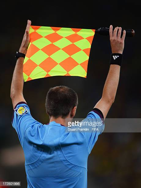 An assistant referee signals for a substitution during the FIFA Confederations Cup Brazil 2013 Final match between Brazil and Spain at Maracana on...