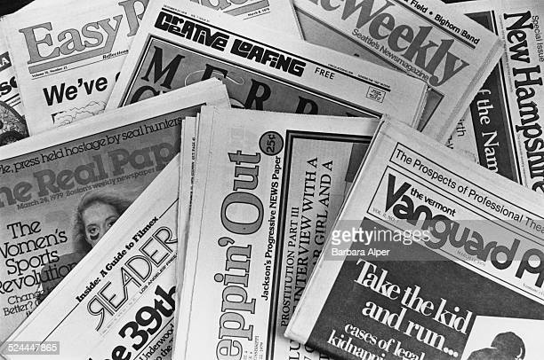 An assortment of alternative newspapers on display at the Association of Alternative Newsmedia convention in Boston Massachusetts USA March 1979