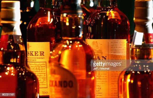 An assortment of bottled whisky is displayed at Glenkinchie distillery March 13, 2008 in Edinburgh, Scotland. Chancellor Alistair Darling has...