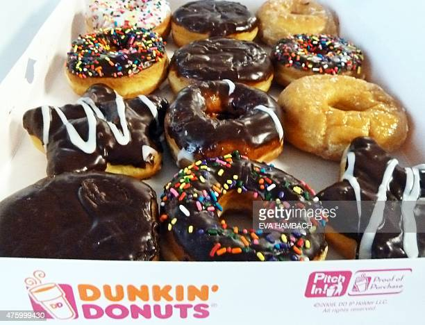 An assortment of Dunkin' Donuts ring doughnuts and filled doughnuts glazed doughnuts and powdered doughnuts is seen in a paper box in Washington DC...