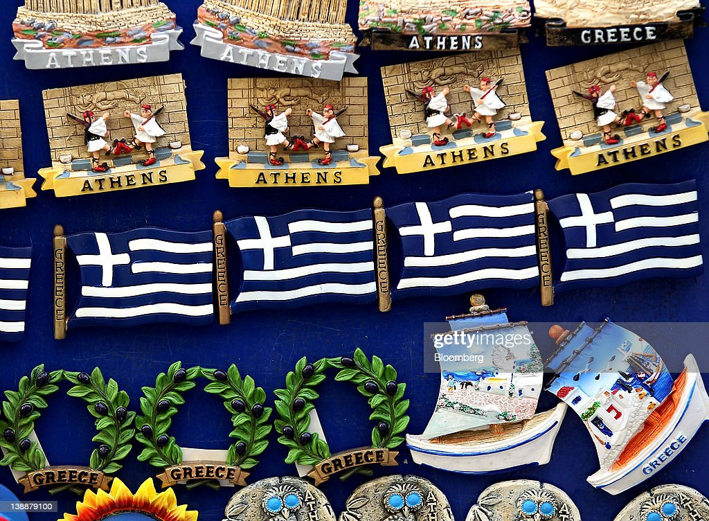 An assortment of Greek-branded fridge magnets are seen for sale at a gift store in Athens, Greece, on Sunday, Feb. 12, 2012. Greek Prime Minister Lucas Papademos won parliamentary approval for austerity measures to secure an international bailout after rioters protesting the measures battled police and set fire to buildings in downtown Athens. Photographer: Simon Dawson/Bloomberg via Getty Images