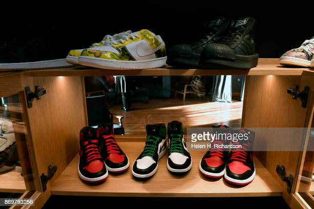 DENVER CO OCTOBER 24 An assortment of high end sneakers are on display at the new bar called SneekEazy on October 24 2017 in Denver Colorado...