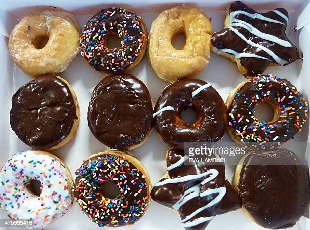 An assortment of ring doughnuts and filled doughnuts glazed doughnuts and powdered doughnuts is seen in a paper box in Washington DC June 5 2015 The...