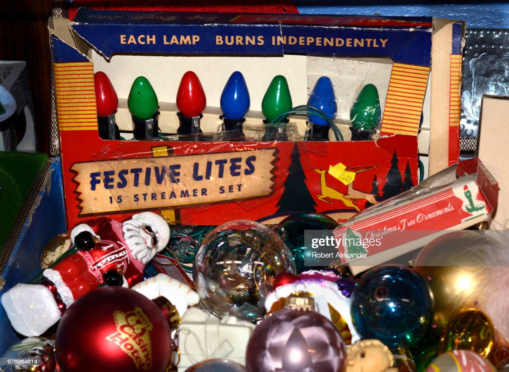 An assortment of vintage Christmas tree lights and ornaments for sale in a  Santa Fe, - Antique Shop Collectibles Pictures Getty Images