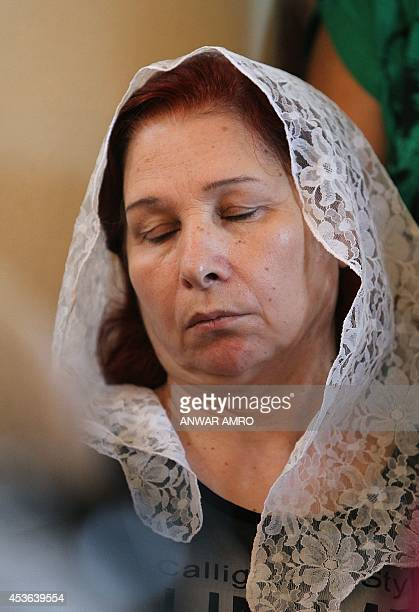 An Assyrian Christian woman attends a mass along with Assyrian worshipers from Iraq Syria and Lebanon at the Saint Georges church in an eastern...
