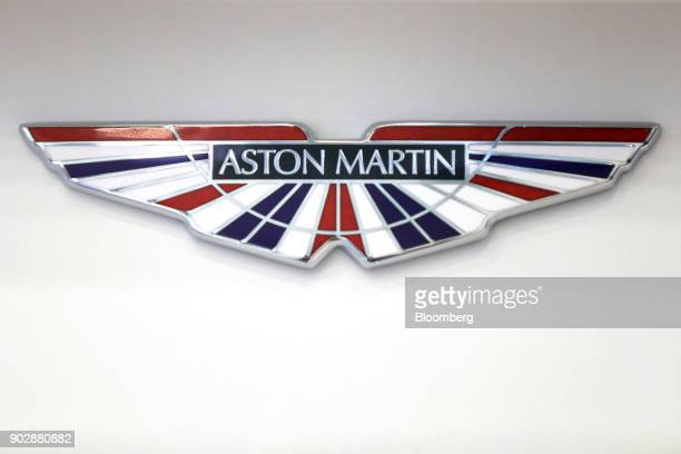 An Aston Martin badge bearing the colors of the Union flag also known as the Union Jack sits in the reception area at the Aston Martin Lagonda Ltd's...