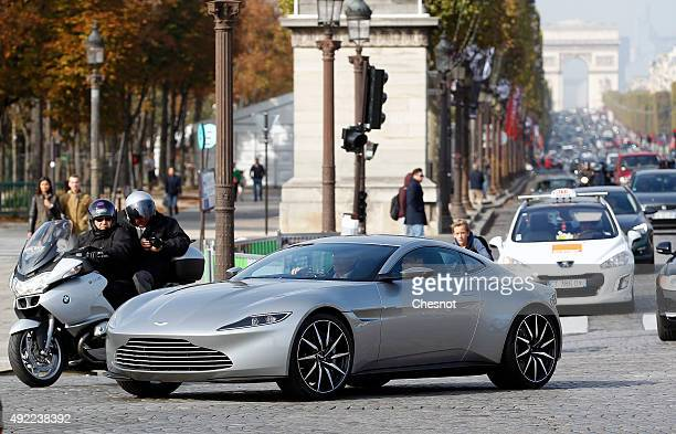 An Aston Martin DB10 the James Bond's car in the next movie 'Spectre' scheduled for November is seen during a ride on Place de la Concorde on October...