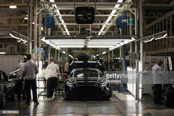 An Aston Martin DB11 luxury automobile sits at the end of the final assembly line at Aston Martin Lagonda Ltd's manufacturing and assembly plant in...
