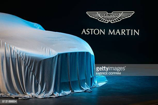 An Aston Martin DB11 model car is covered at the stand of the British carmaker during the press day of the Geneva Motor Show on March 1, 2016 in...