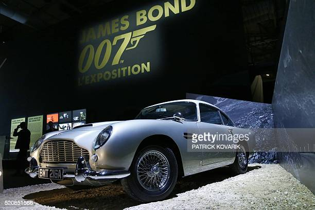 An Aston Martin DB5 is displayed as part of an exhibition dedicated to James Bond which presents more than 500 original objects related to the famous...