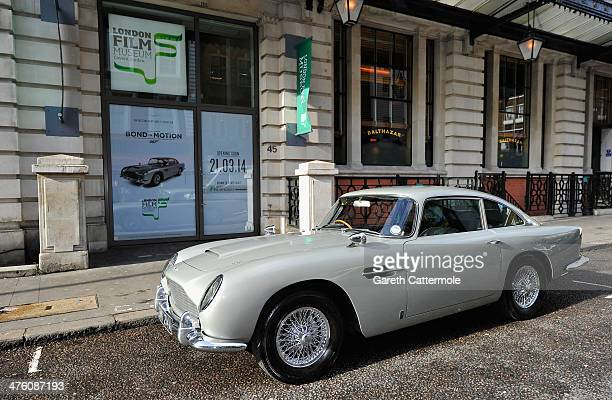 An Aston Martin DB5 used in the film Goldeneye is loaded in to the London Film Museum ahead of the Bond in Motion exhibition opening 21st March at...