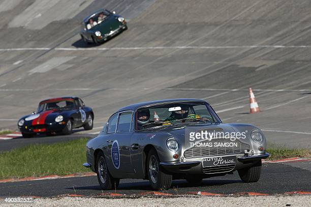 An Aston Martin DB6 Saloon is driven during the first edition of the 'Les grandes heures de l'automobile' a strictly authentic historic cars and...