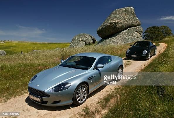 An Aston Martin Db9 And Porsche Carrera S Luxury Vehicles At Nachrichtenfoto Getty Images