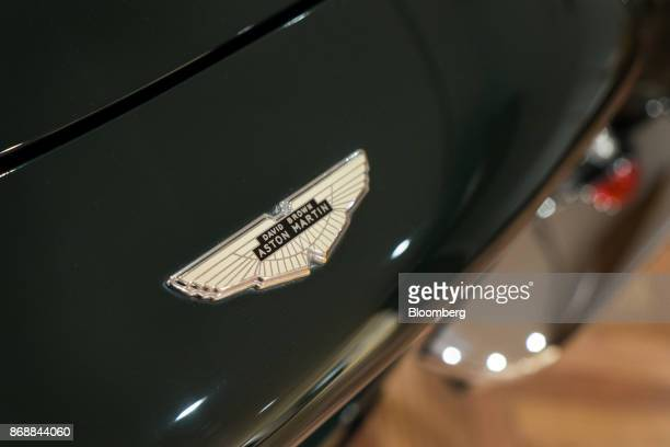 An Aston Martin Lagonda Ltd badge is seen on a DB6 Mk2 Volante automobile at a showroom in Tokyo Japan on Wednesday Nov 1 2017 The luxury sportscar...