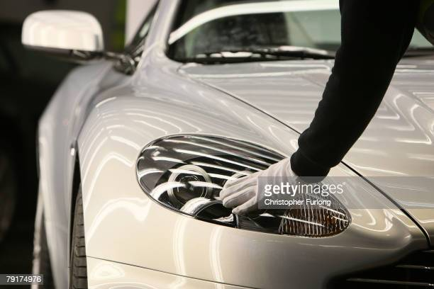 An Aston Martin motor car is checked in a light tunnel during the final inspection at the companies new assembly plant on January 23 2008 in Gaydon...
