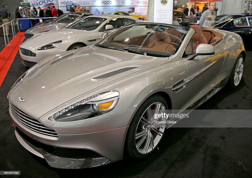 an aston martin price tag 326 843 00 at the new england auto show on news photo getty images 2013 the boston globe the boston globe