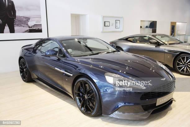 An Aston Martin Vanquish luxury automobile sits on display at an Aston Martin Lagonda Ltd showroom in Singapore on Tuesday Sept 19 2017 Aston Martin...