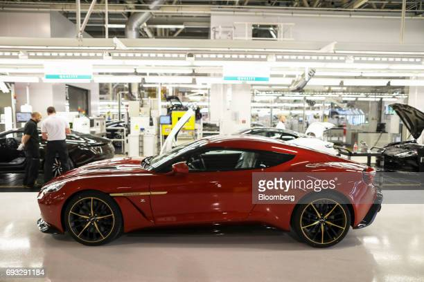An Aston Martin Vanquish Zagato luxury automobile sits next to the final assembly line at Aston Martin Lagonda Ltd's manufacturing and assembly plant...
