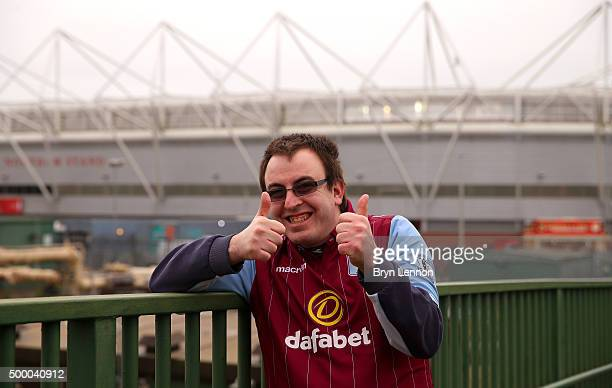 An Aston Villa fan poses for photographs outside the stadium prior to the Barclays Premier League match between Southampton and Aston Villa at St...