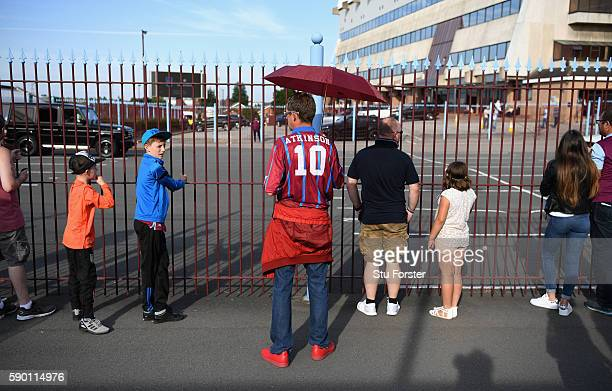 An Aston Villa supporter wears a Dalian Atkinson shirt prior to the Sky Bet Championship match between Aston Villa and Huddersfield Town at Villa...